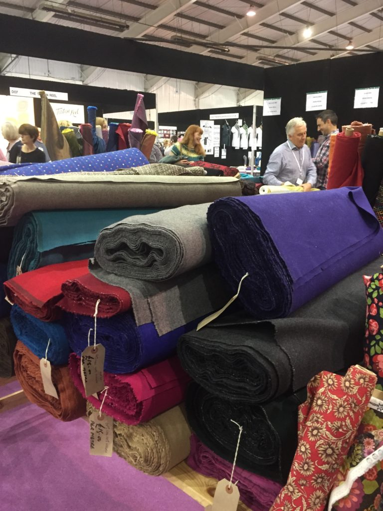 Rolls of fabric on a table
