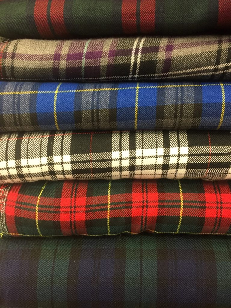 Different tartan fabrics stacked on top of each other