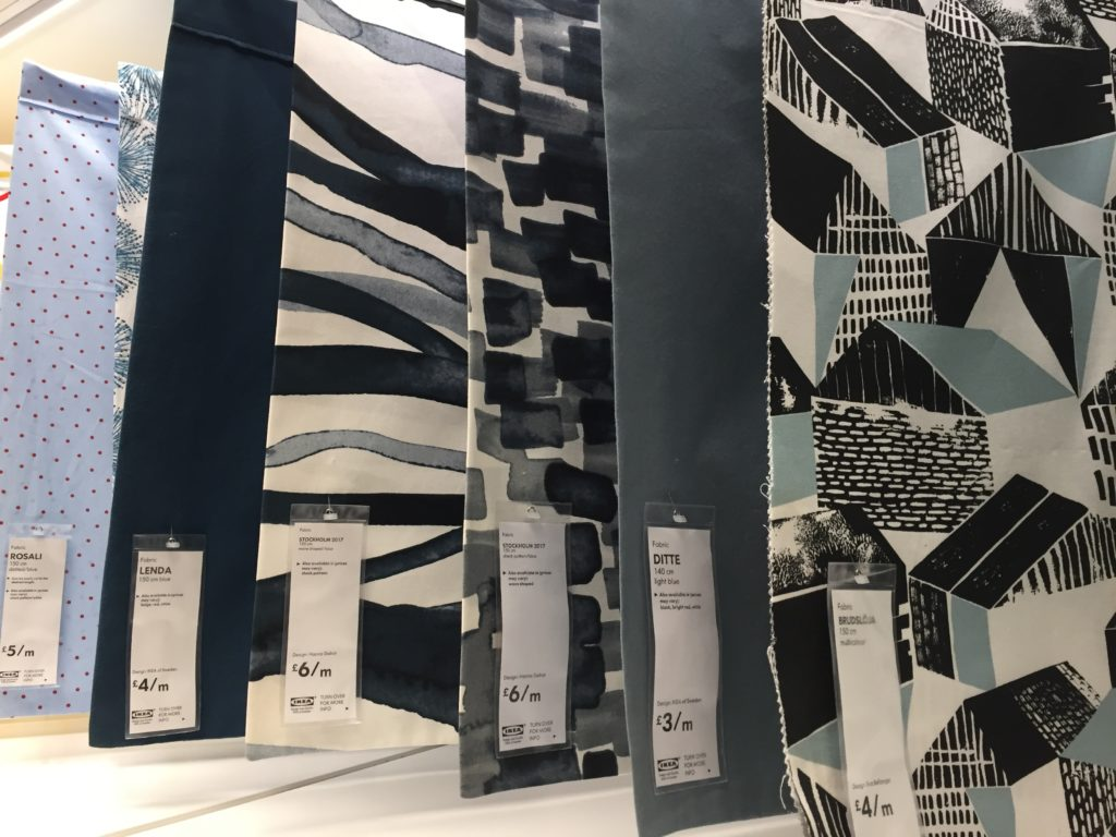 Samples of Ikea fabric hung in a row