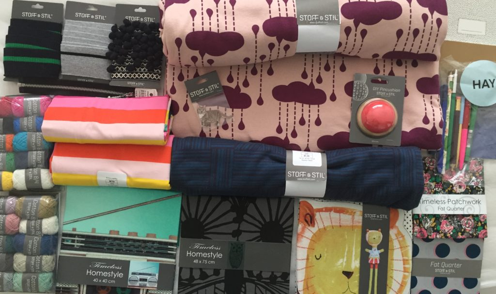 Fabric and sewing items lined up next to each other