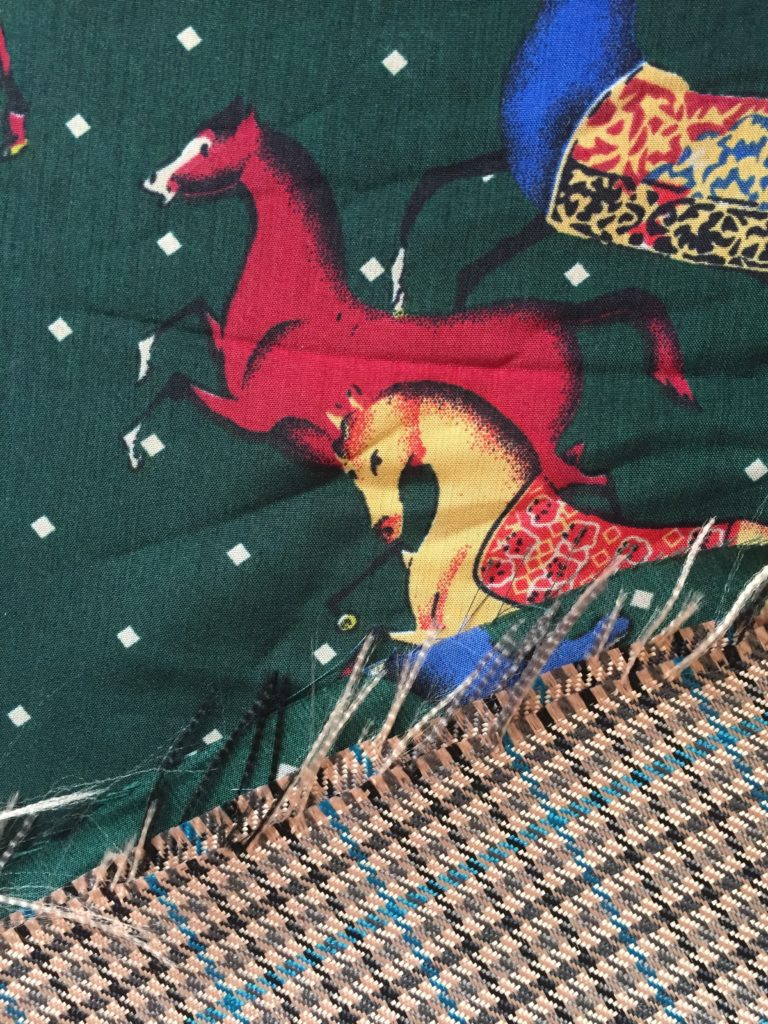 Horse print lining fabric and heavily fraying woven polyester