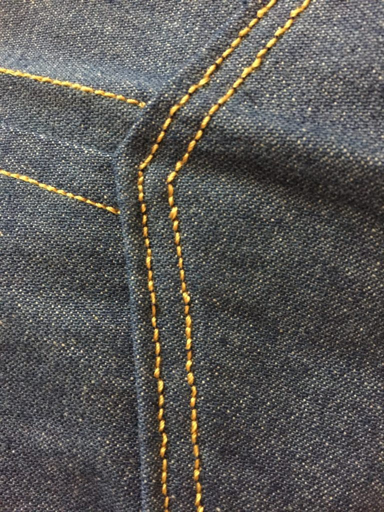 Topstitching on denim pocket