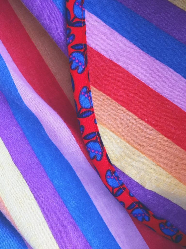 Floral bias binding applied to rainbow skirt seams