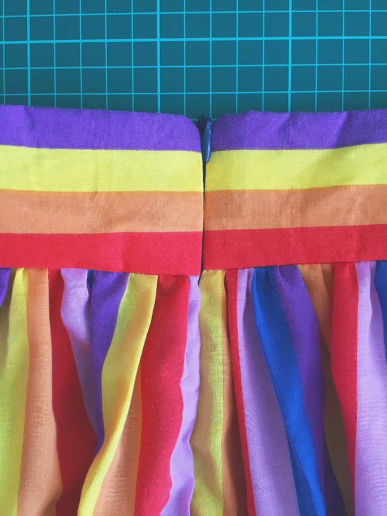 Invisible zip on rainbow gathered skirt waistband